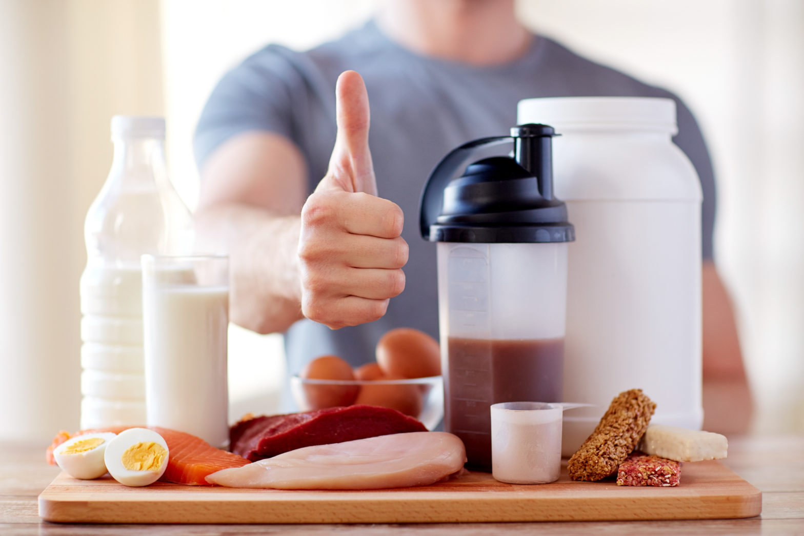 man with protein food showing thumbs up