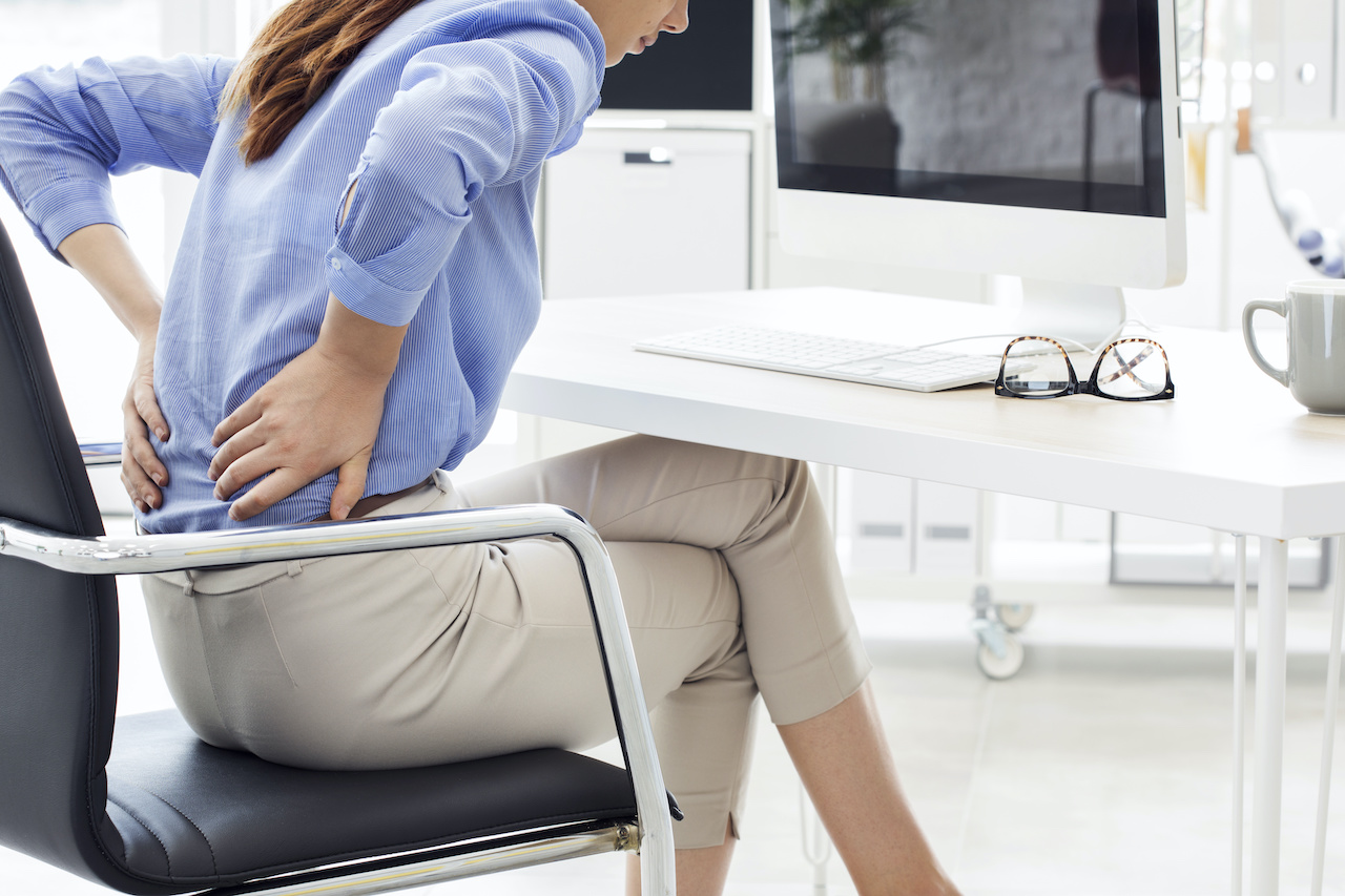 Businesswoman with pain in back